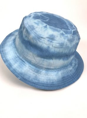Sea Me Happy tie-dye Bucket Hat, great with your festival outfit for an immediate holiday feeling