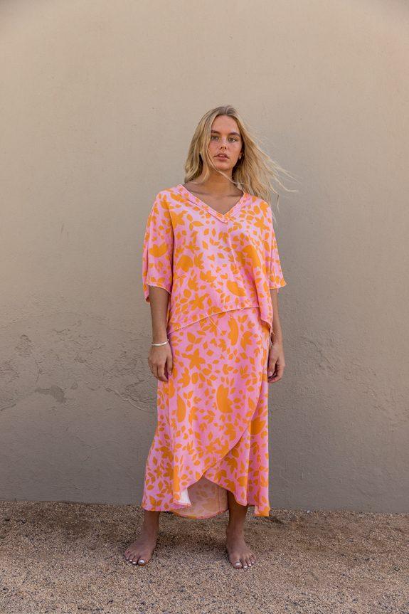Sea Me Happy Noosa wrap skirt and Noosa Top orange-pink