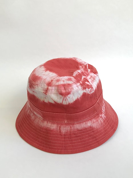 Sea Me Happy tie-dye Bucket Hat brick, great with your festival outfit for an immediate holiday feeling